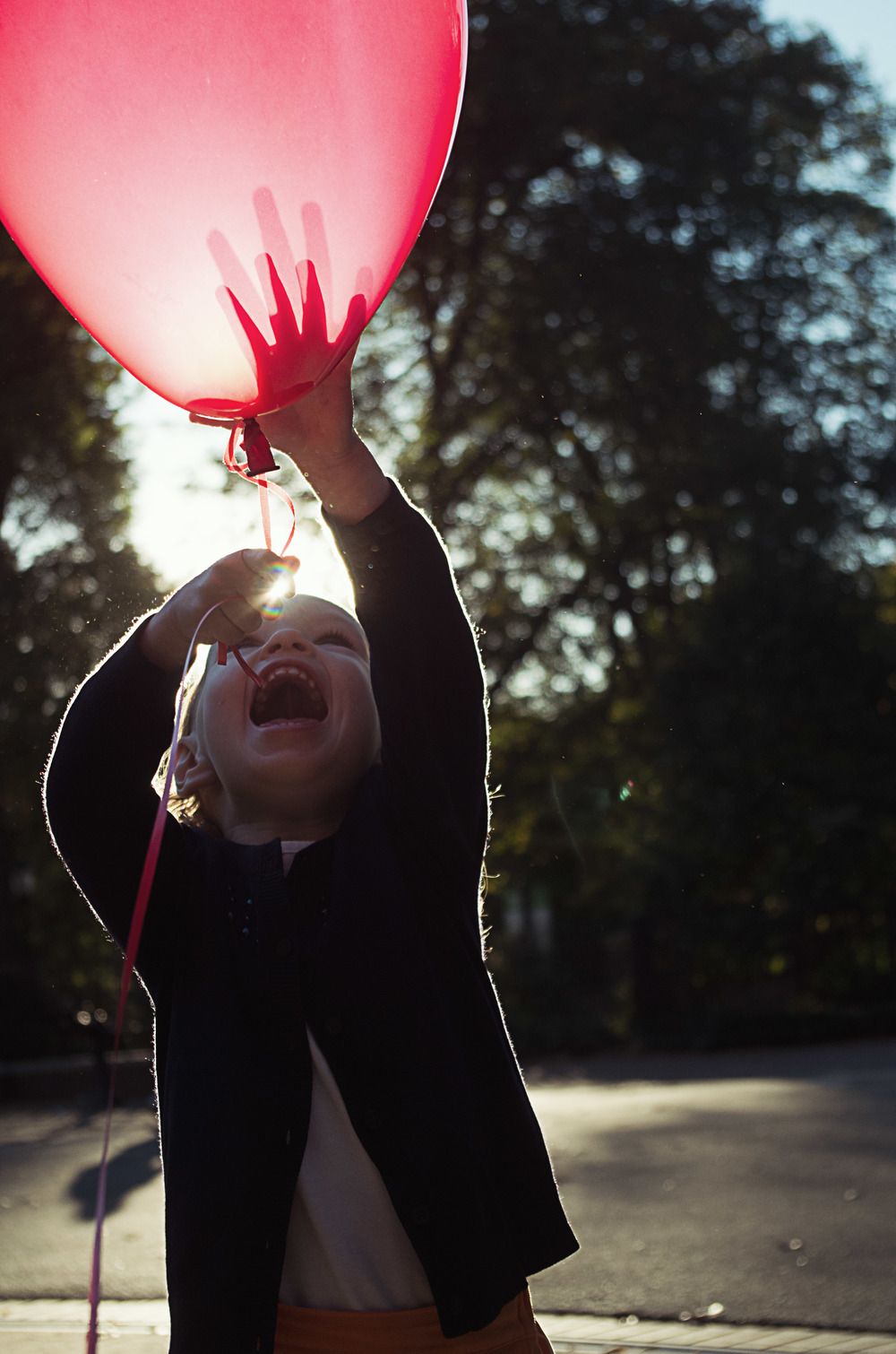 On Friday, I shot some family portraits for the Griffin family. I brought Charlotte a balloon and after warming up to it a bit, she couldn't get enough. There were lots of really great photos from the day, but this is probably my favorite capture.