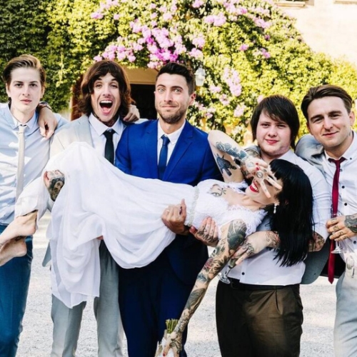 Here she is with BMTH at her wedding. Oli (her husband) is the one open-mouthed with joy.