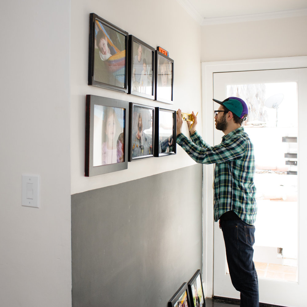 A professional art installer at my relaxed client's home.