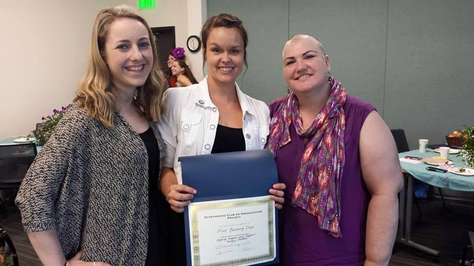 Stephanie (center) receives the District Club Award for Best Service Project