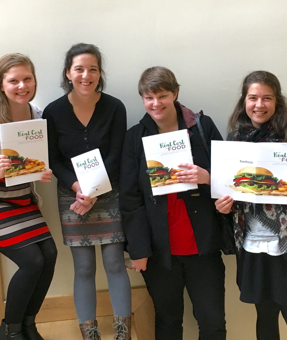 "Jamie, Sara, Erin, and Leyla stop for a photo at the ""The Real Cost of Food"" at American University."