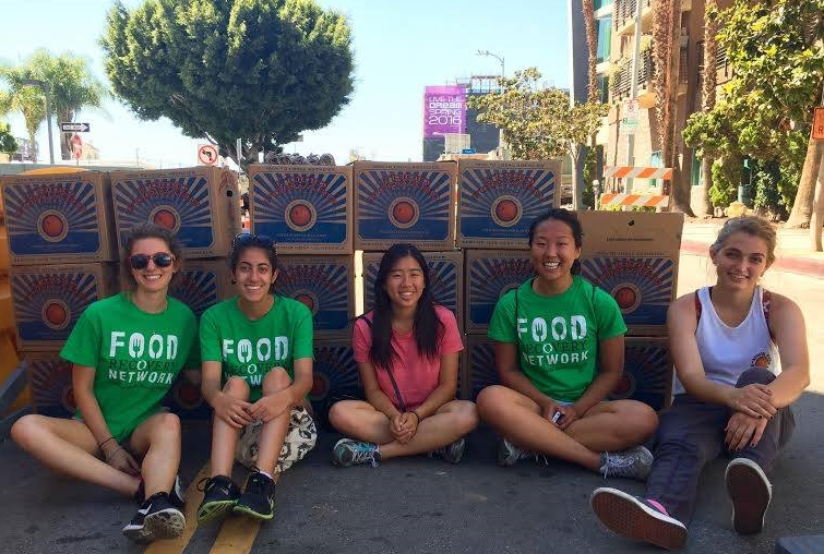 FRNds at USC rest in the shade after recovering leftover produce from the Hollywood Farmers Market.