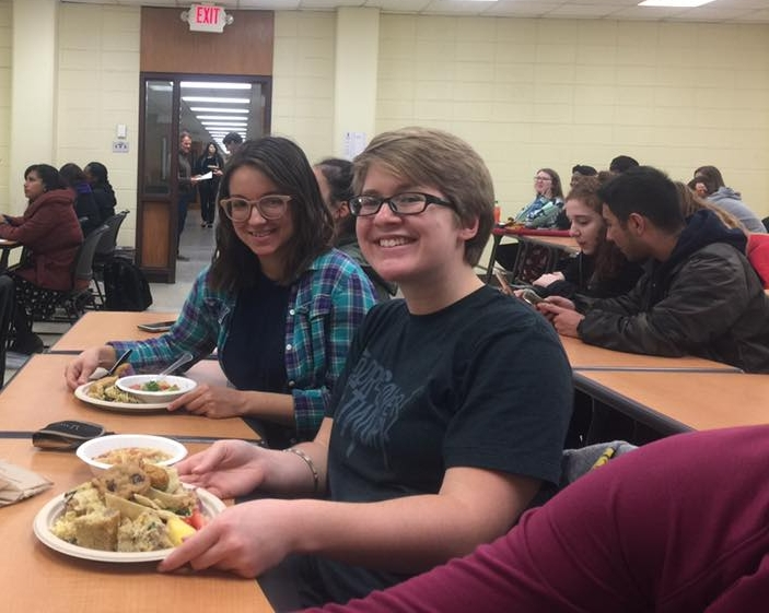 Olivia (left) and Cameron (right) enjoying the vegan potluck.