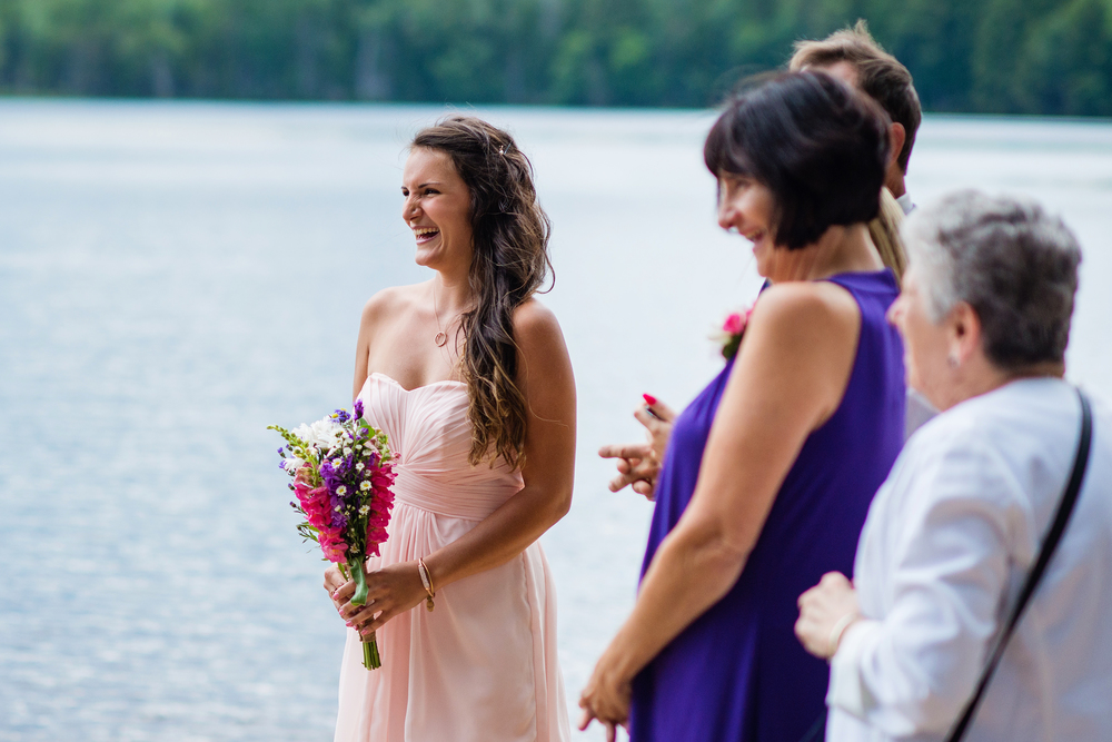 sister of groom laughing adirondack wedding