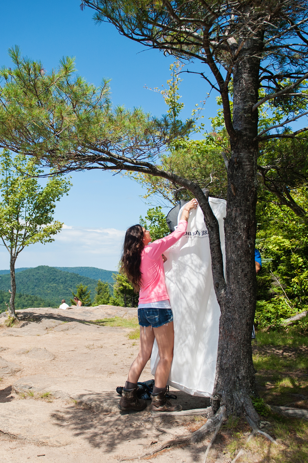 Bride hanging her dress