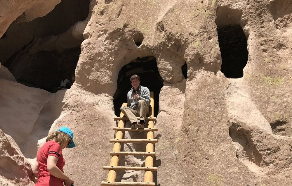 JD Sitting Outside a Cliff-Dwelling at Bandelier National Monument