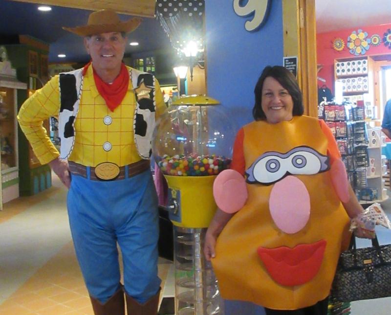 Mary dressed as Mrs. Potato Head and Joe dressed as Woody