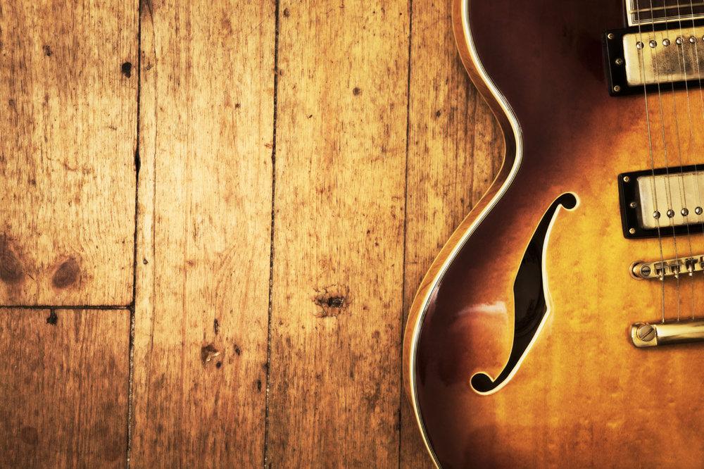 Guitar on wood.jpg