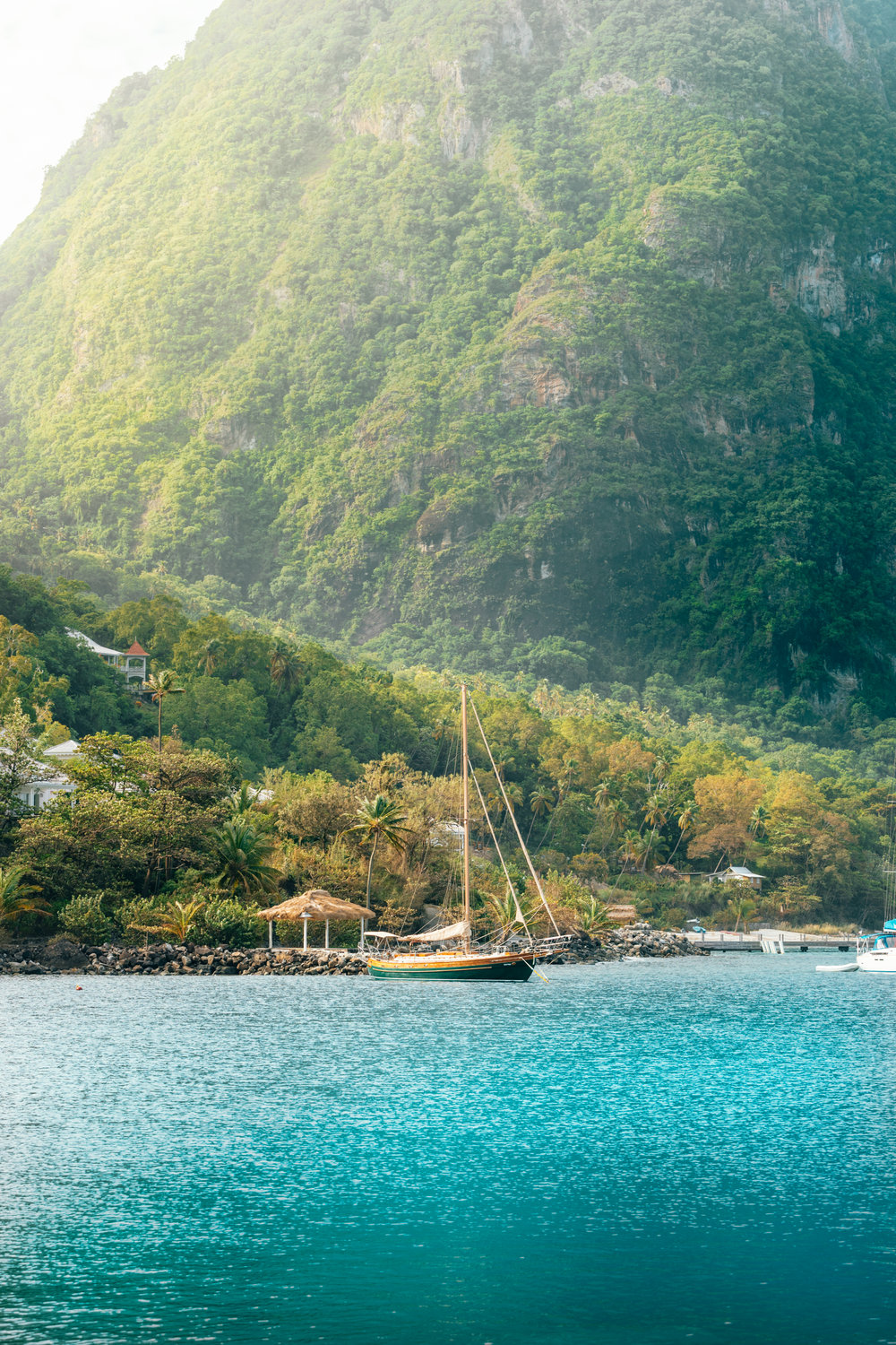 St Lucia waters with boat and Piton mountains.jpg