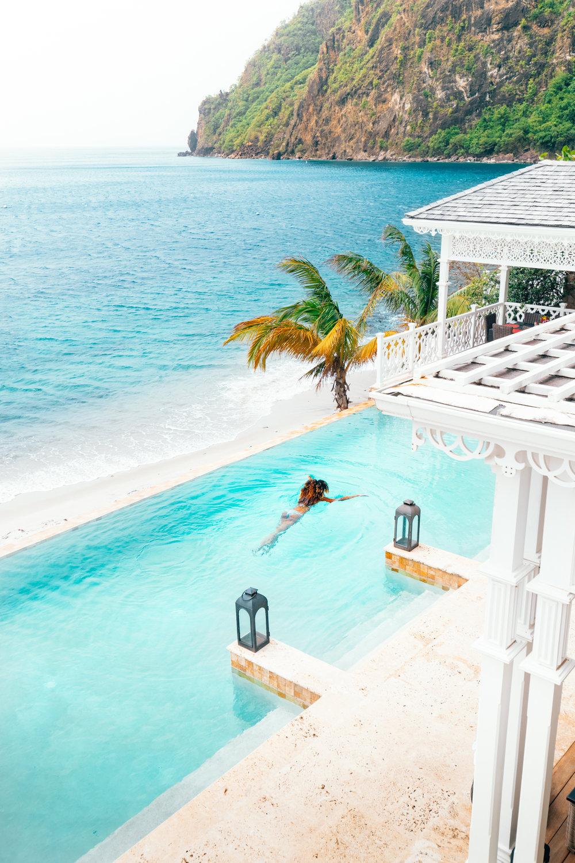 Woman swimming in a pool at Sugar Beach, A Viceroy Resort.jpg