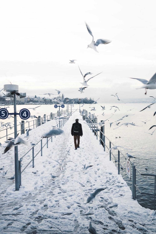 Man walking in the snow in Switzerland.jpg