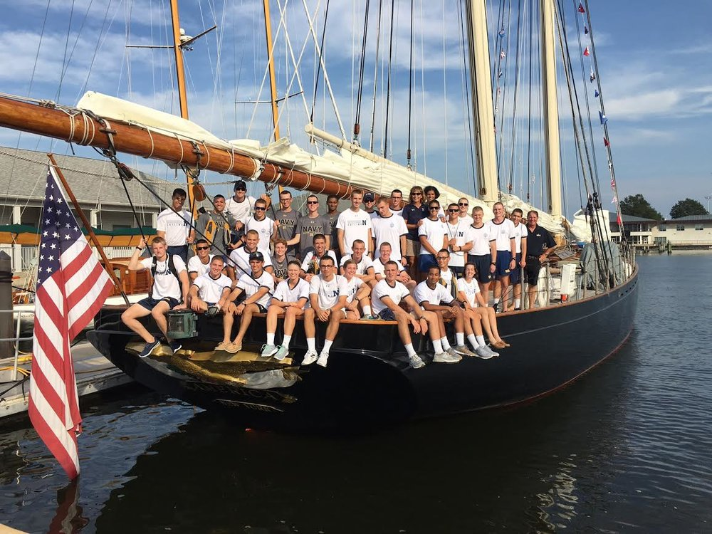 Members of the Sailing Team onboard America in the Naval Academy's Santee Basin.