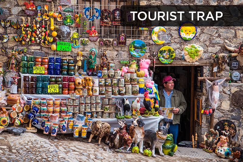 This term has a negative connotation and refers to attractions that were designed as commercial areas in order to encourage tourists to spend money on overpriced tickets, food, and souvenirs.
