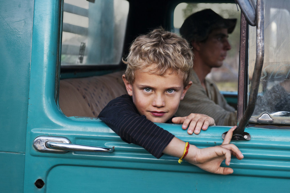 Steve McCurry, Lambari, Brazil', 2010. A Farmer's Son in his Father's Truck.