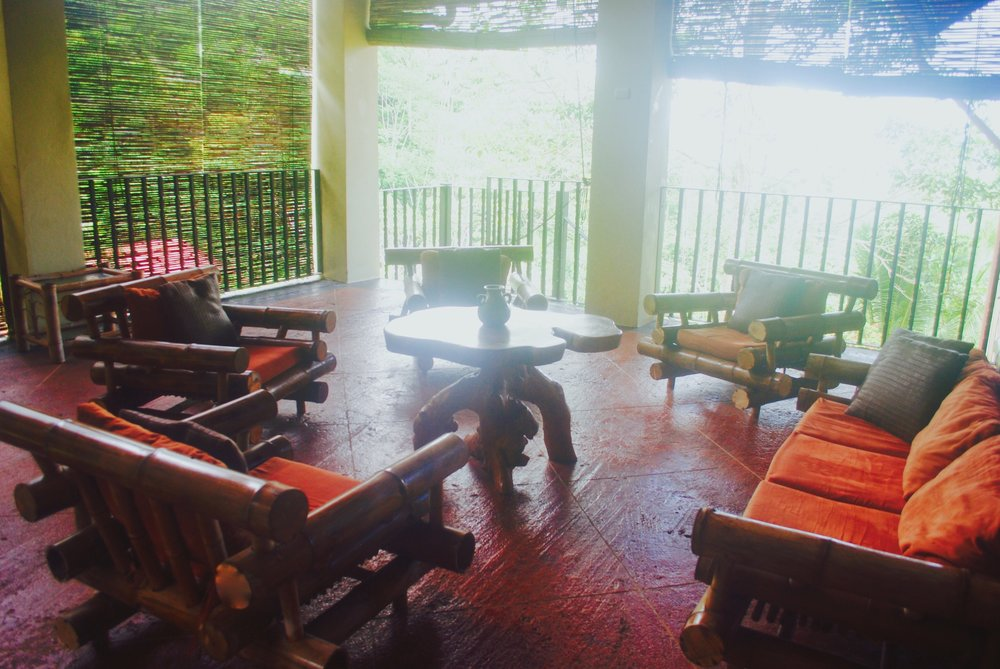 This is just one section of the open-air veranda. For our yoga sessions, we'll clear the furniture out of the way.