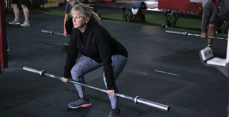 All barbell movements in a workout begin with an unloaded barbell to ensure proper mobility and movement patterns.