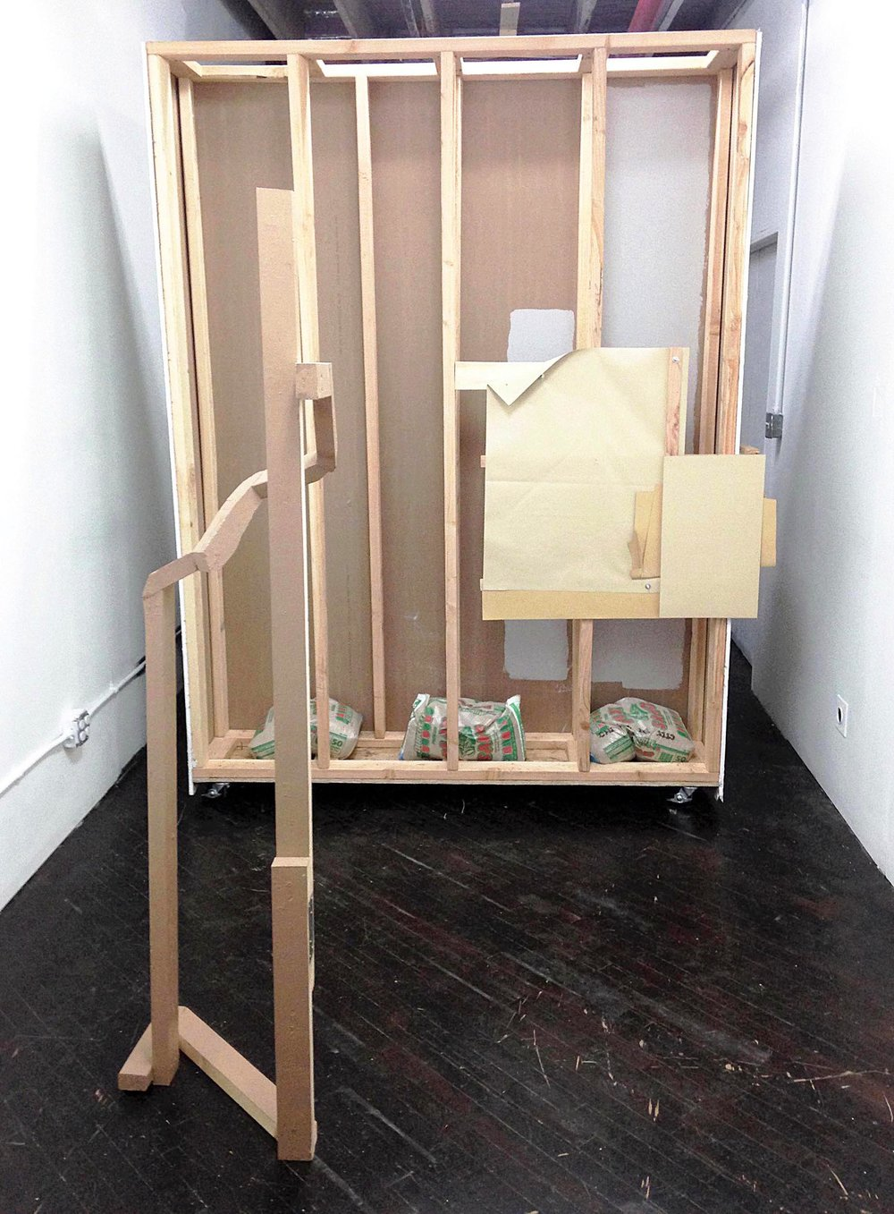 wood, house paint, paper, vinyl banner, book board, hardware (2016)