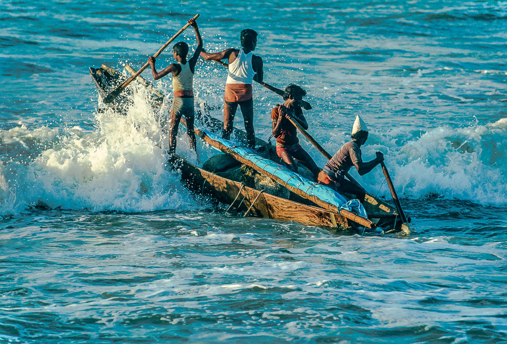 Telugu Fishermen Fight To Launch Into Waves On The Bay Of Bengal