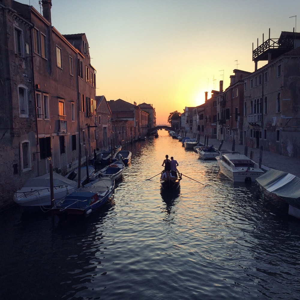 Sunset over a canal in Venice, Italy