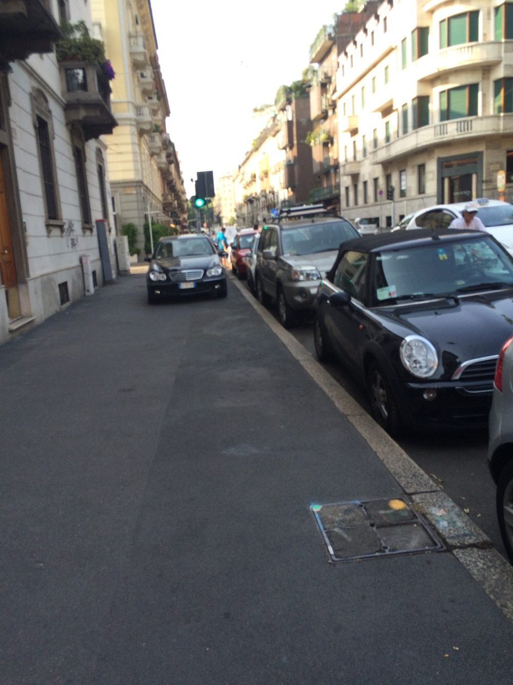 For instance, here is a car just casually parked on the sidewalk. In Milan, anywhere is a parking space if you just believe!