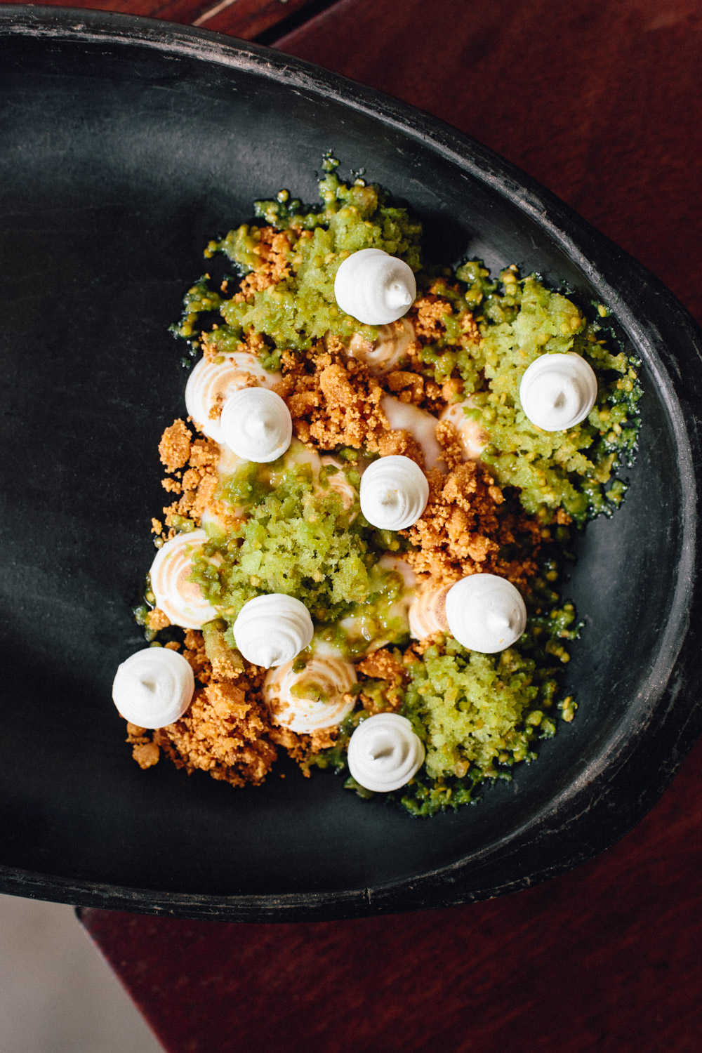 "A dessert adapted from traditional Colombian ""Merengon"". The green sauce is blended Lulo fruit, with crumble made from milk-powder, butter and coffee-syrup caramel. Beneath that is a guanábana (soursop fruit) compote. Topped with a mix of fresh and ""baked"" meringues: made in a dehydrator, half of them blow-torched. Tart, sweet, fresh with various textures.. Mmmm!"