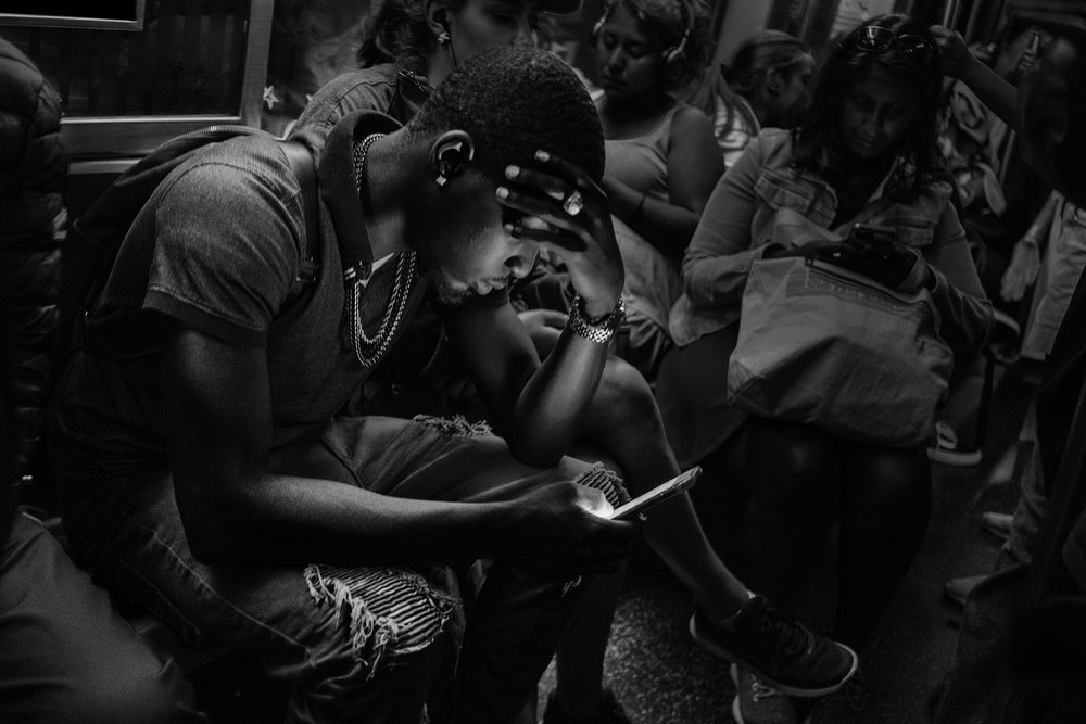 Brklyn_Subway_2018_Teenage_Bling_Boy_checking _phone-005.jpg