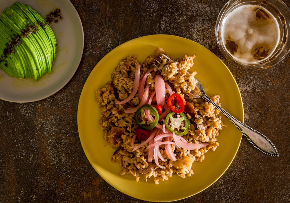 Pulled pork barbecue mixed with farro, pickled red onion, green and red jalapeños  :  avocado dressed with cider vinaigrette, smoked sea salt  :  pilsner