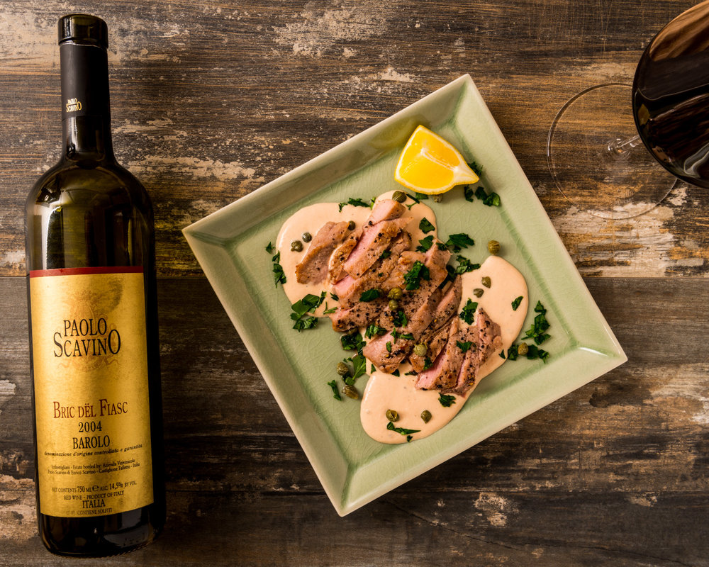 In the spirit of Piedmont, Italy  : Vitello Tonnato-inspired veal seared on cast iron, with tuna-caper sauce, lemon, parsley and capers   : Paired with 2004 Paolo Scavino Barolo Bric del Fiasc