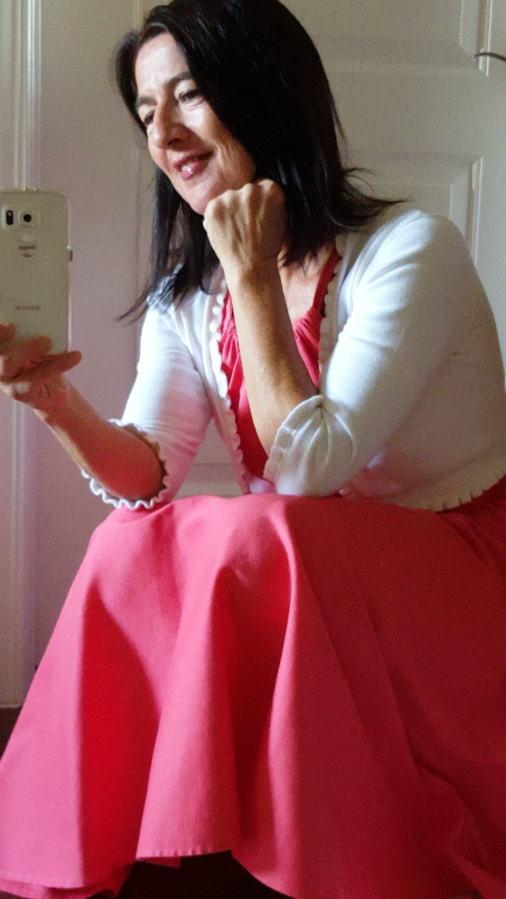 pink dress w white sweater.png
