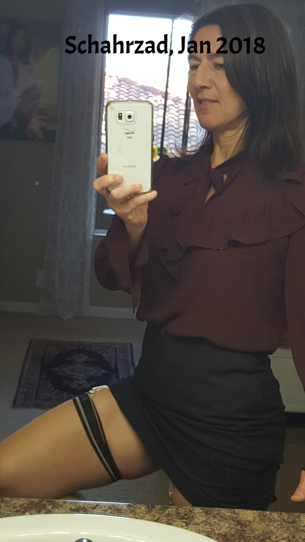blouse and black skirt showing hose.png