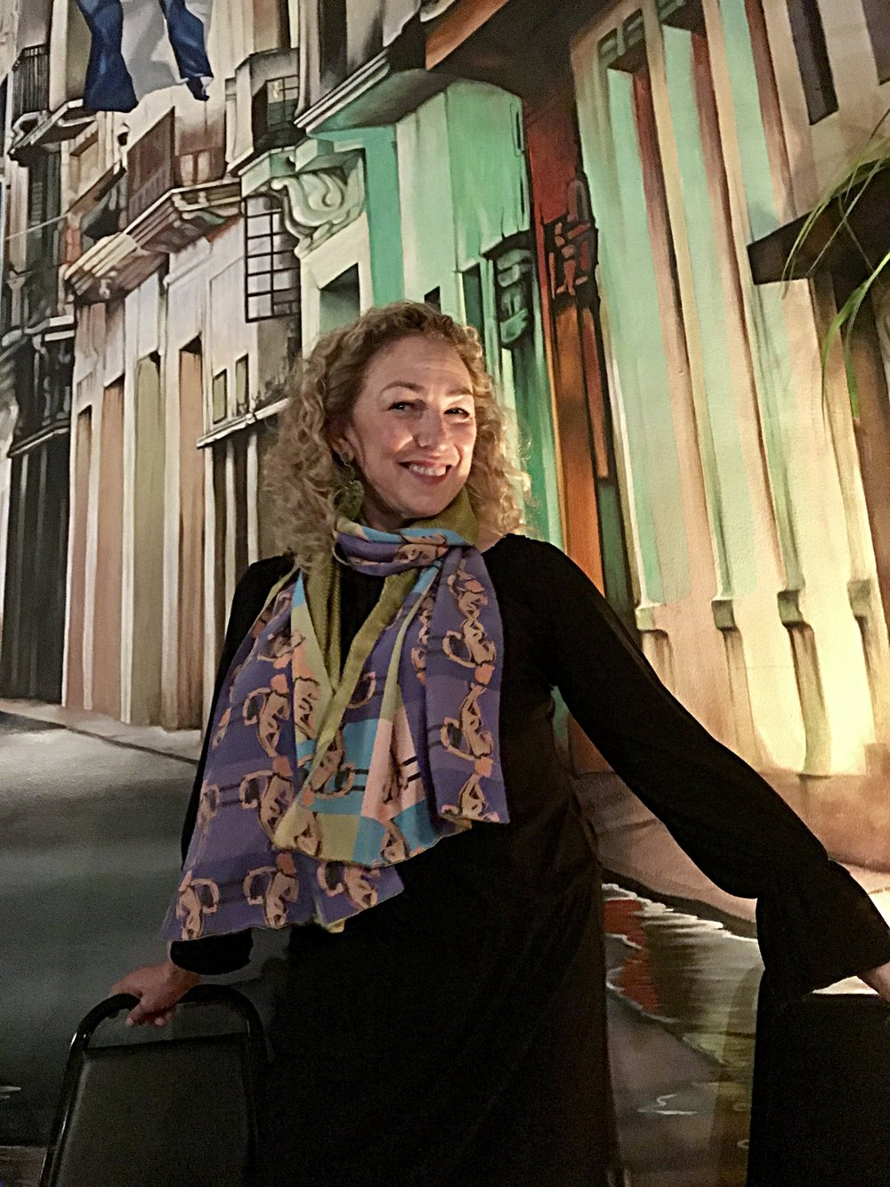 First night in NYC at a Cuban restaurant in East Harlem. The mural behind me looks like a stage set or I'm actually IN Cuba. Yes, that's my microbatch textile scarf I'm wearing.