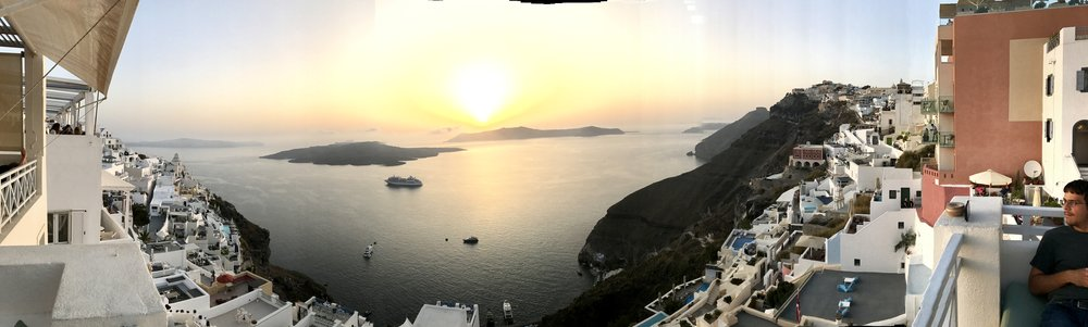 Striking sunset views atop Santorini after riding the cable car/incline to get there. Others took a mule ride.