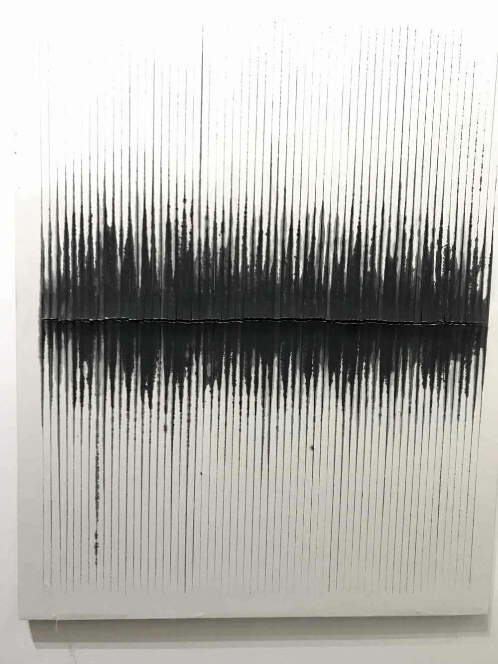 Seen at Untitled, this painting is composed of cut and scratched paint and canvas.