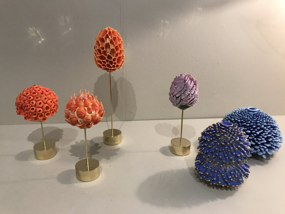 These are gem-like underwater-looking ceramic sculptures at Fog.