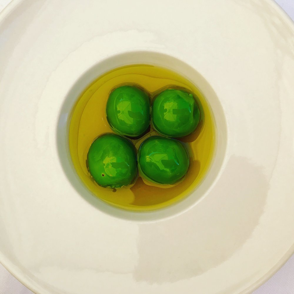 This amuse bouche was one of many delicious taste surprises in Cadiz. It looks like olives, but when you pop it into your mouth and bite down, gazpacho fills your mouth.