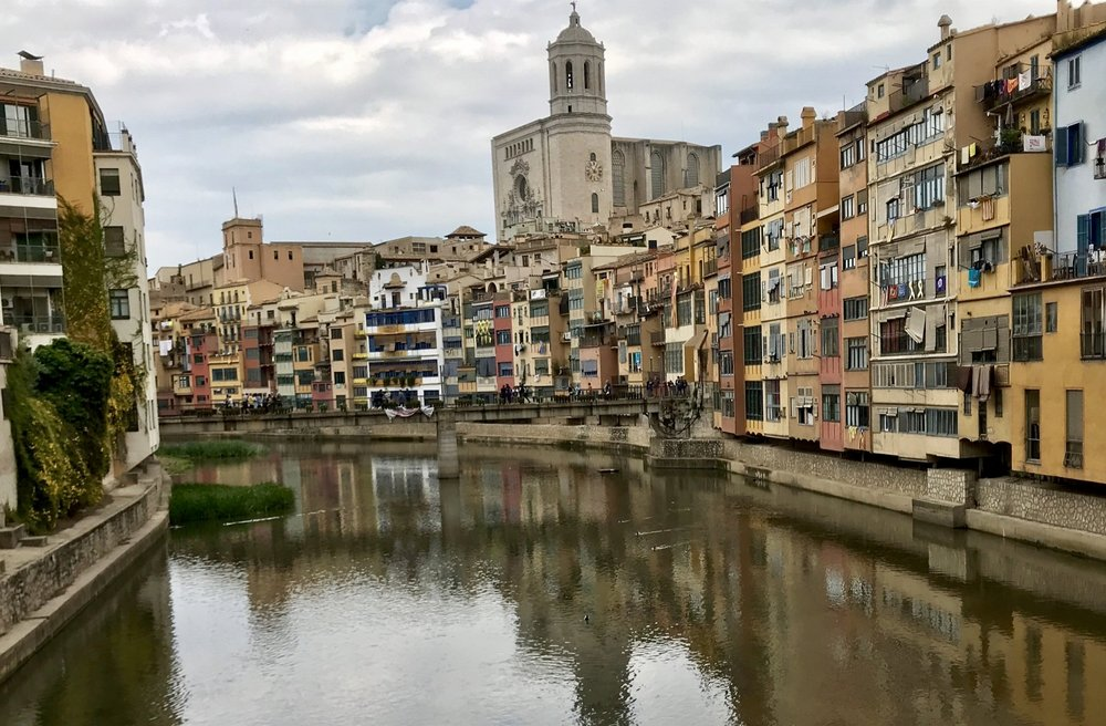 Classic view of Girona with the Onyar River running through it. On the right is the Old Quarter and the left side is the newer part of the city.