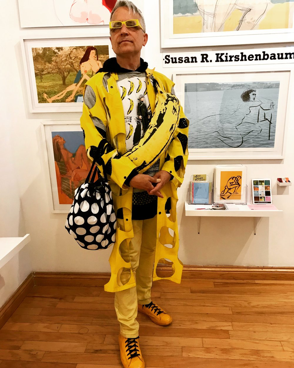 This man has a clear identity. His artwear is taken to the extreme. He attended one of my recent openings at  City Art Coop Gallery  and happily posed for me. That's my July wall behind him.