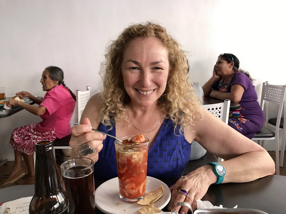 Shrimp cocktail! A funky fun place near the market with great food and drinks. Very local.