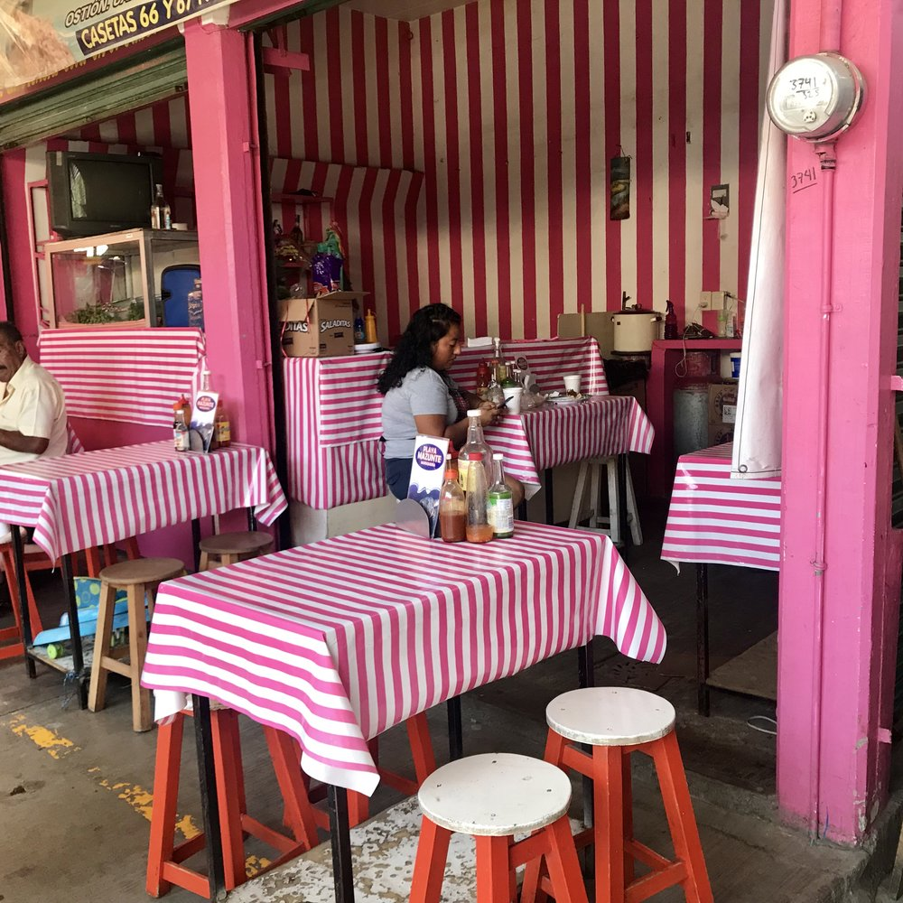 Candy cane stripes make this a stand-out food stall in the market outside of Oaxaca.