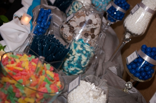 Custom blue and white candy buffet with bride and groom favorite candies designed by Sweet I Do's Wedding Day Management Specialist Arizona