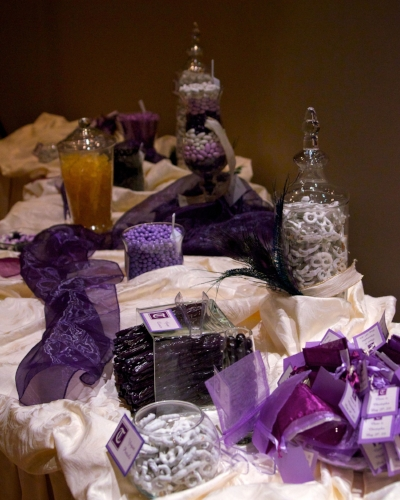 Custom purple and gold wedding candy buffet designed by Sweet I Do's Wedding Day Management Specialist Arizona