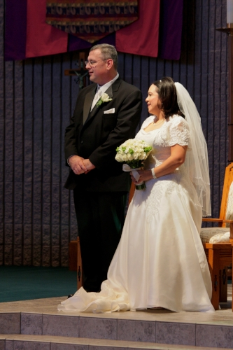 Bride and groom at their Catholic church wedding ceremony coordinated by Sweet I Do's Wedding Day Management Specialist at St. Thomas in Mesa Arizona