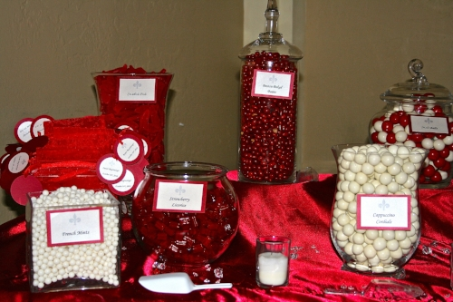 Custom red and white wedding candy buffet designed by Sweet I Do's Wedding Day Management Specialist in Arizona