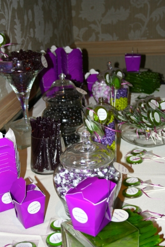 Custom purple and green wedding candy buffet designed by Sweet I Do's Wedding Day Management Specialist in Arizona