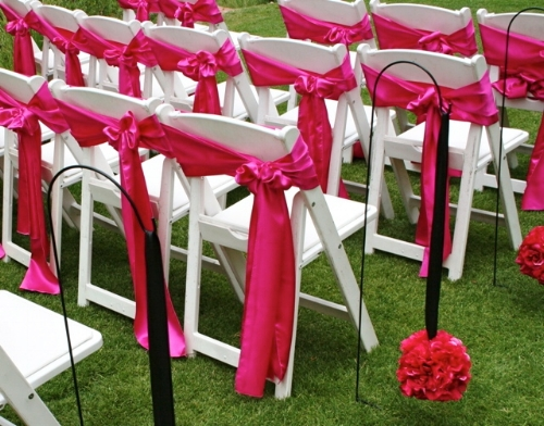 Pink chair ties created by Sweet I Do's Wedding Day Management Specialist at Kohl's Ranch in Payson Arizona