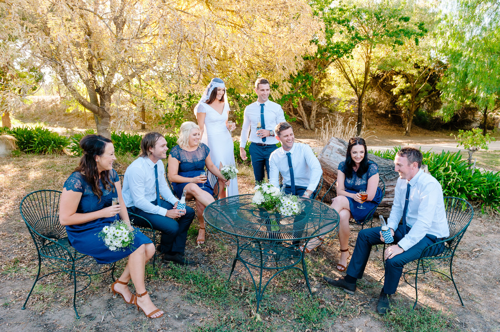 Bridal Party relaxing outside at Chateau Dore winery, Bendigo