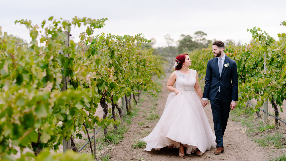 Bride and Groom in the Vineyard at Sutton Grange Winery