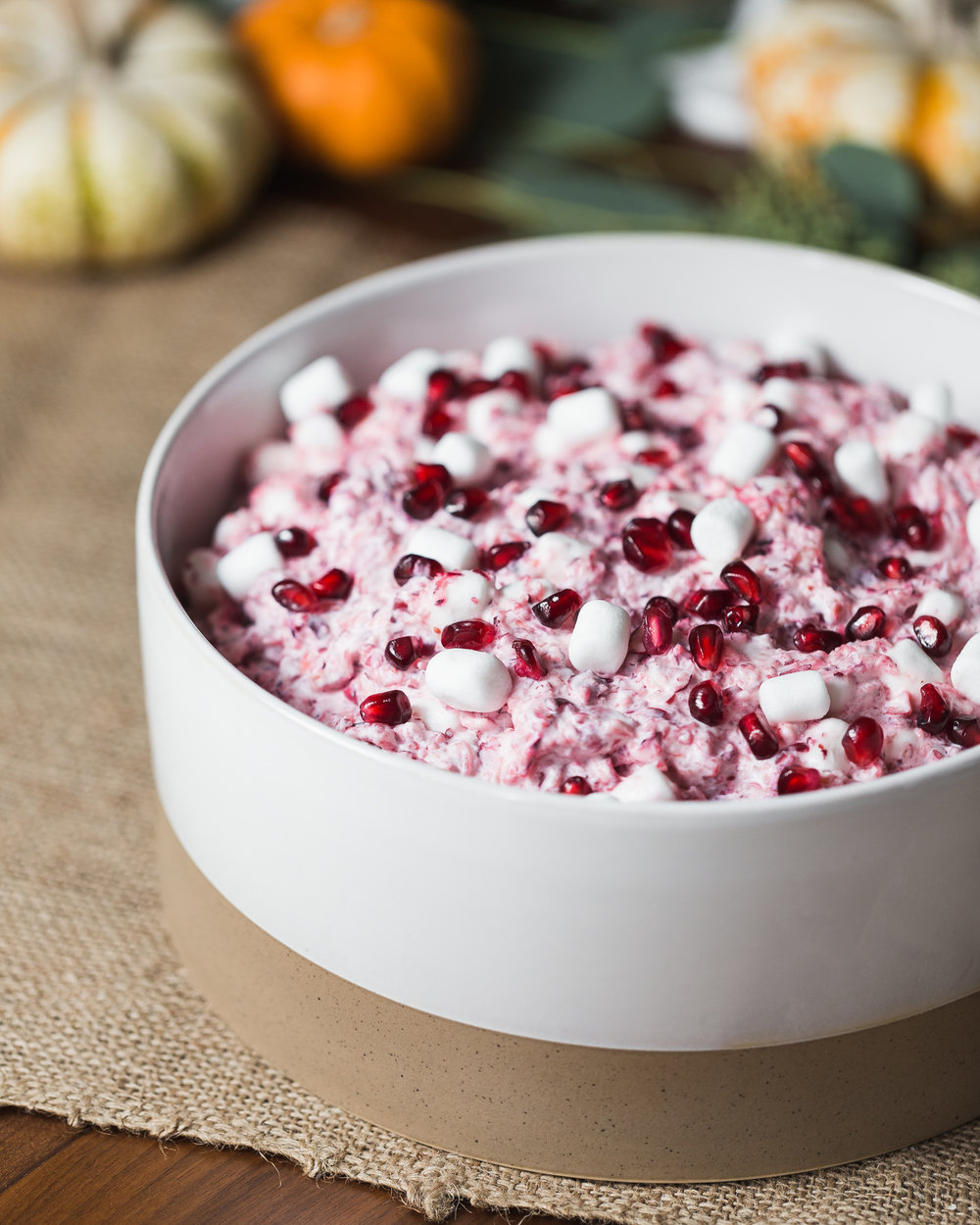 Cranberry Salad - Yield: 8-10 servings3 cups whole cranberries, fresh¾ cup sugar1 (20 oz. can) crushed pineapple, drained2 cups miniature marshmallows1 cup heavy whipping cream½ cup powdered sugar1 teaspoon vanilla extract1 cup pomegranate seedsChop cranberries in food processor or blender until fine and no large pieces remain. Transfer to mixing bowl and stir sugar into cranberries. Cover and chill for at least 2 hours or up to overnight.Drain any accumulated juices from cranberries and reserve. Stir in drained pineapple and marshmallows. Set aside.In a mixing bowl, whip heavy cream adding powdered sugar and vanilla to sweeten until soft peaks form. Fold into cranberry mixture until fully incorporated.Refrigerate or freeze. Garnish with pomegranate seeds