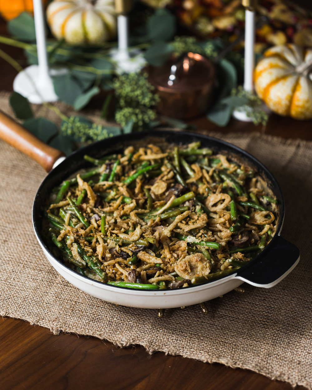 Stovetop Green Bean Casserole - Yield: 6-81 1/2 pounds haricots verts (French string beans), stem ends removed3 tablespoons unsalted butter12 oz white mushrooms, ends removed and slicedKosher salt and cracked black pepper1 teaspoon Dijon mustard2 cloves garlic, minced3 tablespoons flour1 cup chicken broth1 cup heavy cream1 cup sour cream1/3 cup fried crunchy fried onionsBring a large pot of salted water to a boil. Add the beans and blanch until crisp but tender, 2-3 minutes. Immediately drain the beans and run cold water over them or plunge them into an ice bath to cool and stop the cooking process. Drain and dry.In a large skillet, melt the butter and add the mushrooms. Season with salt and pepper, to taste, and add mustard. Cook the mushrooms, 5-8 minutes until they give off most of their liquid.Using a whisk, add the garlic and flour to the mushrooms. Stir to incorporate then add the chicken broth. Bring to a simmer. Stir in the cream and sour cream, and bring to a simmer, tasting to adjust seasoning. Cook mixture until it's thickened and coats the back of a spoon, about 10 minutes.To assemble, stir the green beans into the mushroom mixture. Simmer on the stove, until the green beans become tender.