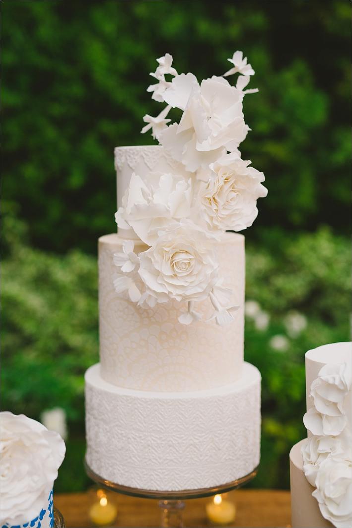 spanish inspired stencil sugar flower wedding cake
